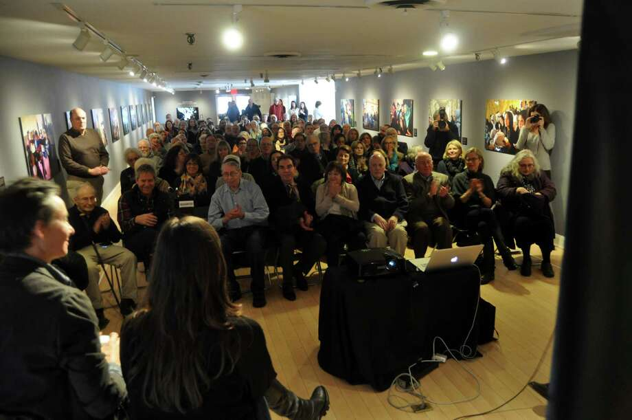 A large crowd turned out Saturday at the Westport Arts Center to hear Lynsey Addario, 1991 Staples High School graduate, discuss her photos from international trouble spots on display in a new exhibit, âÄúOn the Wire: Veiled Rebellion.âÄù Photo: Nancy Guenther Chapman / Westport News contributed