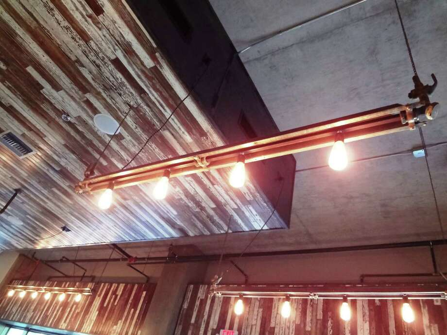 Salvaged wood and industrial lighting in Local Coffee speaks to the history of the Pearl Brewery complex. Photo: Photo By Steve Bennett