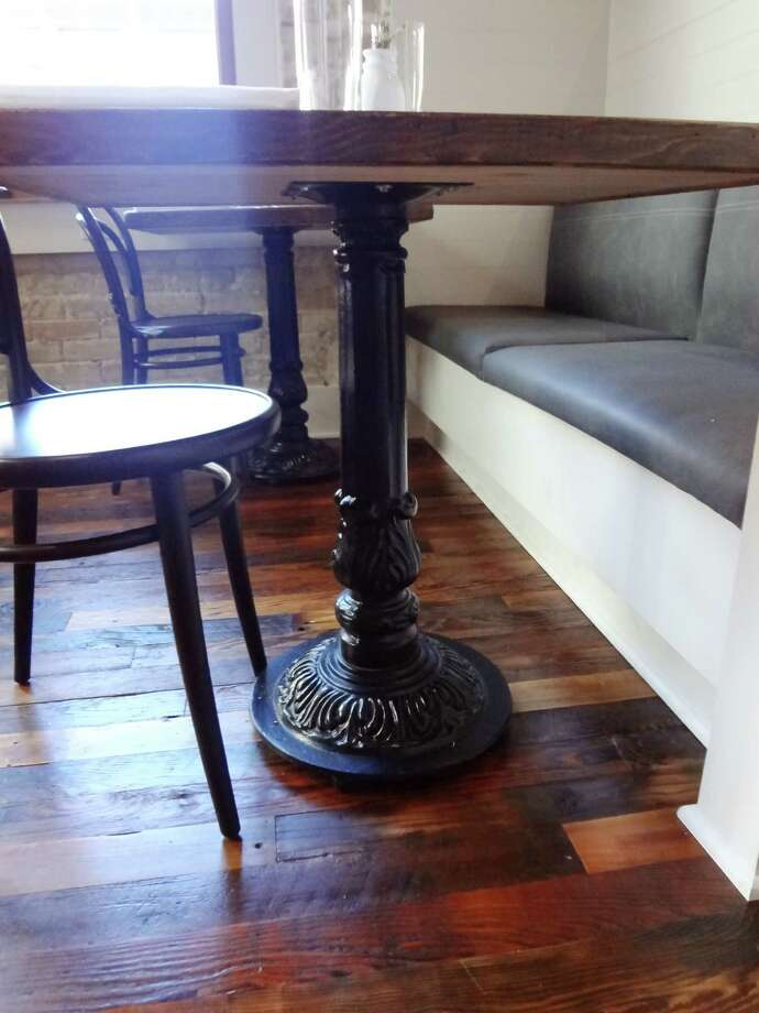 Decorative table bases came from the old Jersey Lilly party room. Photo: Photo By Steve Bennett