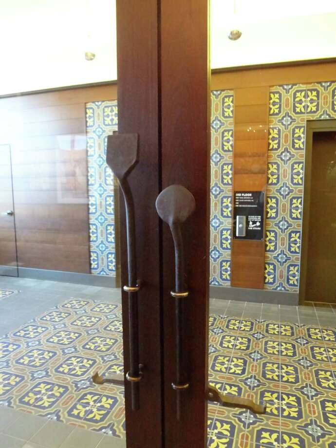 Old tools make great door handles in the Pearl administrative offices. Photo: Photo By Steve Bennett