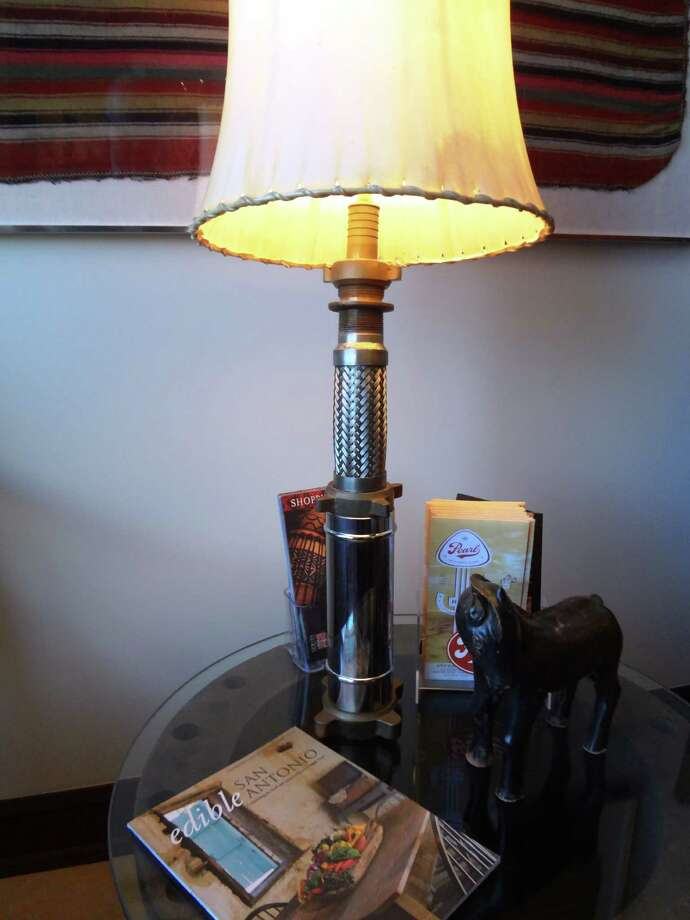Salvaged industrial material makes an interesting lamp base. Photo: Photo By Steve Bennett