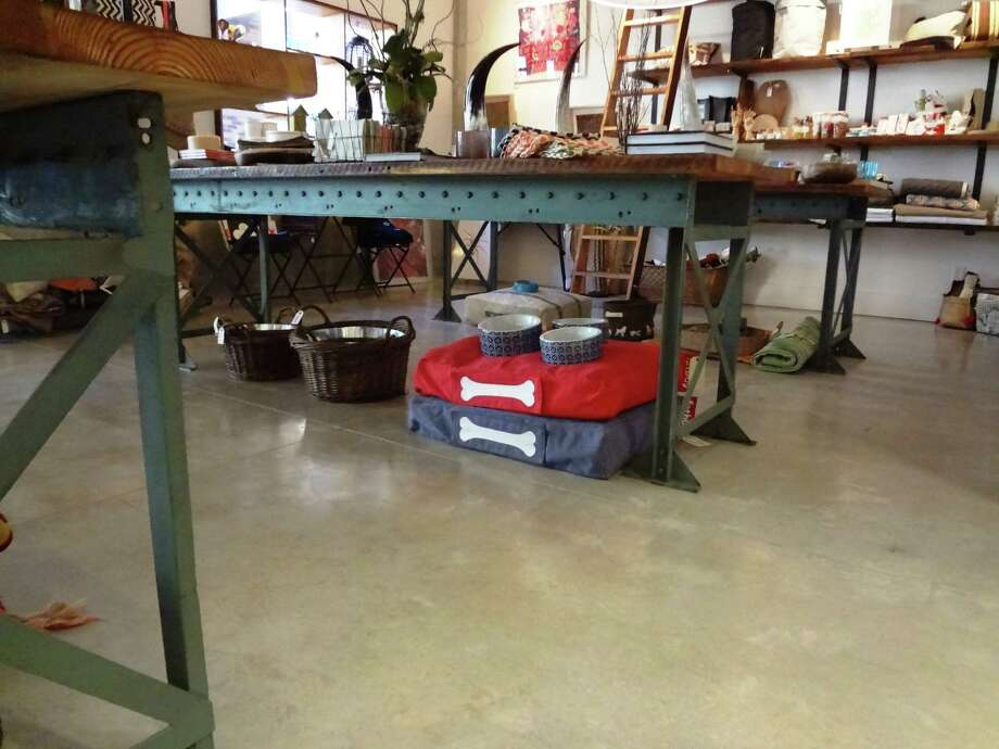 Conveyor belt supports and old wood make good display tables in Tiny Finch. Photo: Photo By Steve Bennett