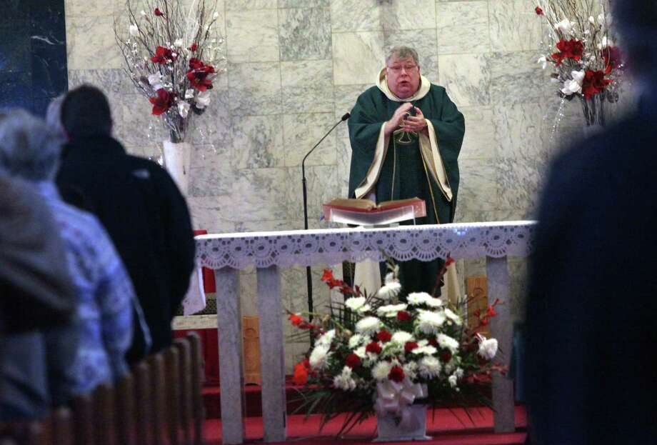 Monsignor Martin Ryan says mass at Our Lady of Grace Church in Stratford, Conn. on Monday, Jan. 26, 2014. Photo: Unknown, B.K. Angeletti / Connecticut Post freelance B.K. Angeletti