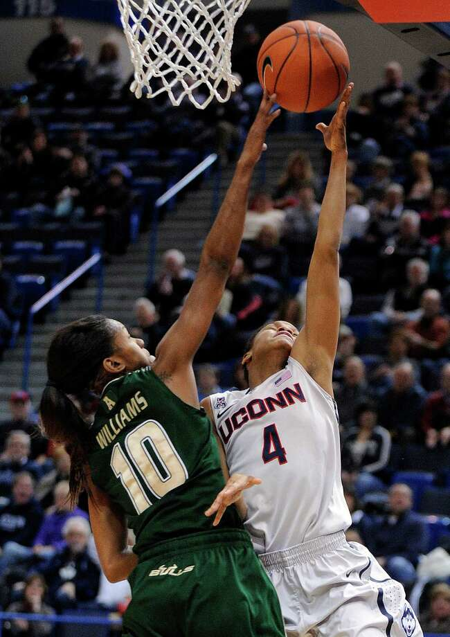 Connecticut's Moriah Jefferson (4) drives past South Florida's Courtney Williams (10) during the first half of an NCAA college basketball game in Hartford, Conn., Sunday, Jan. 26, 2014. Photo: Fred Beckham, AP / Associated Press