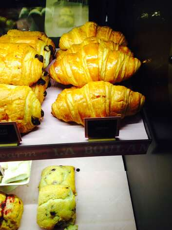 "Croissant (kwah-SAHN): A flaky, buttery, crescent-shaped roll. Audio: Click here to hear the term ""Croissant."" Photo: Candice Choi, AP  / A2014"