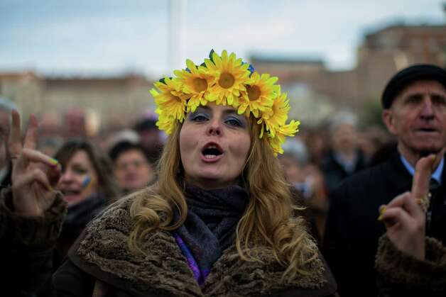 A Ukrainian woman shouts slogans during a demonstration in support of Ukraine's protests against Viktor Yanukovych's government in Madrid, Spain, Sunday, Jan. 26, 2014. The protests began in late November in Ukraine after President Viktor Yanukovych shelved a long-awaited agreement to deepen ties with the European Union, but they have been increasingly gripped by people seeking more radical action even as moderate opposition leaders have pleaded for a stop to violence. In the past week, demonstrators have seized government administration buildings in a score of cities in western Ukraine, where Yanukovych's support is weak and desire for European ties is strong. Photo: Andres Kudacki, AP  / AP