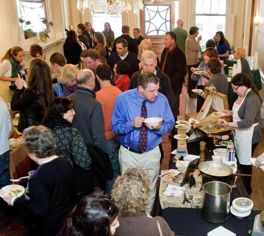 Many folks circulate between the 35 Ridgefield vendors at the 15th annual Taste of Ridgefield held at the Ridgefield Community Center . Sunday, Jan. 26, 2014 Photo: Scott Mullin / The News-Times Freelance