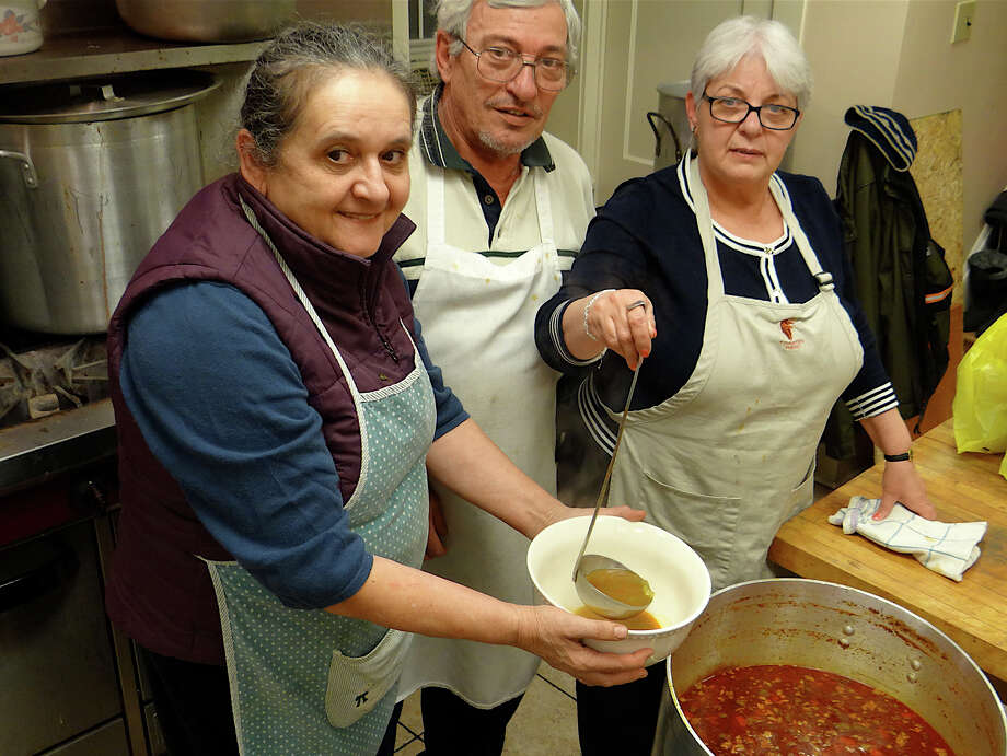 Cooks in the kitchen at Calvin United Church's annual venison and beef gulyas dinner Saturday were Gizella Sedenszki, John Simon and Edith Simon. Photo: Mike Lauterborn / Fairfield Citizen contributed