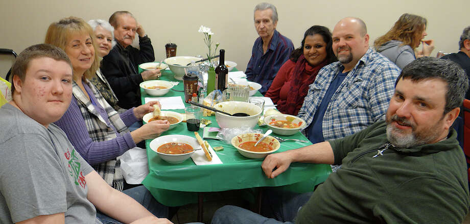 Members of the Gelsi, Meizies, Torok, Repasi and Metcalf families enjoy Calvin United Church's annual dinner of Hungarian venison and beef gulyas on Saturday. Photo: Mike Lauterborn / Fairfield Citizen contributed