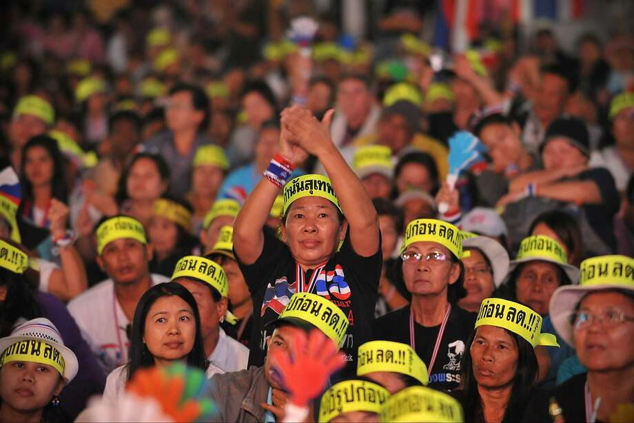 Antigovernment protesters listen to a speech by protest leader Suthep Thaugsuban at a rally in Bangkok. Photo: Rufus Cox, Getty Images