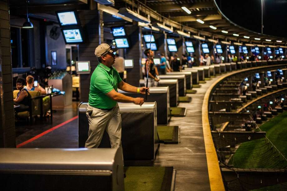 Kurt McCormick watches the flight of his golf ball during the Suits and Boots party at Top Golf on Saturday, Jan. 25, in Houston. Suits and Boots is a charity event supporting Heroes Project where party goers wear bathing suits and/or boots. (Michael Starghill Jr. / For the Houston Chronicle) Photo: Michael Starghill Jr. / For The Houston Chronicle
