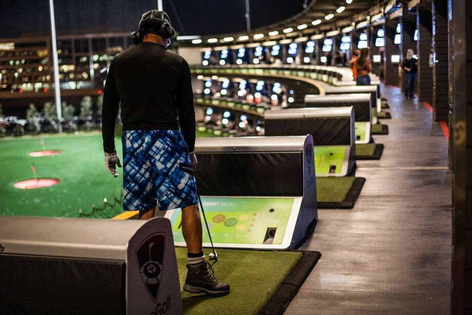 Byon Williams lines up a shot at Top Golf during the Suits and Boots party on Saturday, Jan. 25, in Houston. (Michael Starghill Jr. / For the Houston Chronicle) Photo: Michael Starghill Jr. / For The Houston Chronicle