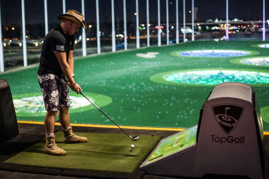 Jesse Metko, a 10-year Army veteran, gets ready to hit a ball at Top Golf during the Suits and Boots party on Saturday, Jan. 25, in Houston. (Michael Starghill Jr. / For the Houston Chronicle) Photo: Michael Starghill Jr. / For The Houston Chronicle