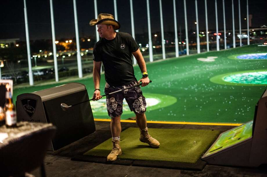 Army vet Jesse Metko looks at his score at Top Golf. (Michael Starghill Jr. / For the Houston Chronicle) Photo: Michael Starghill Jr. / For The Houston Chronicle