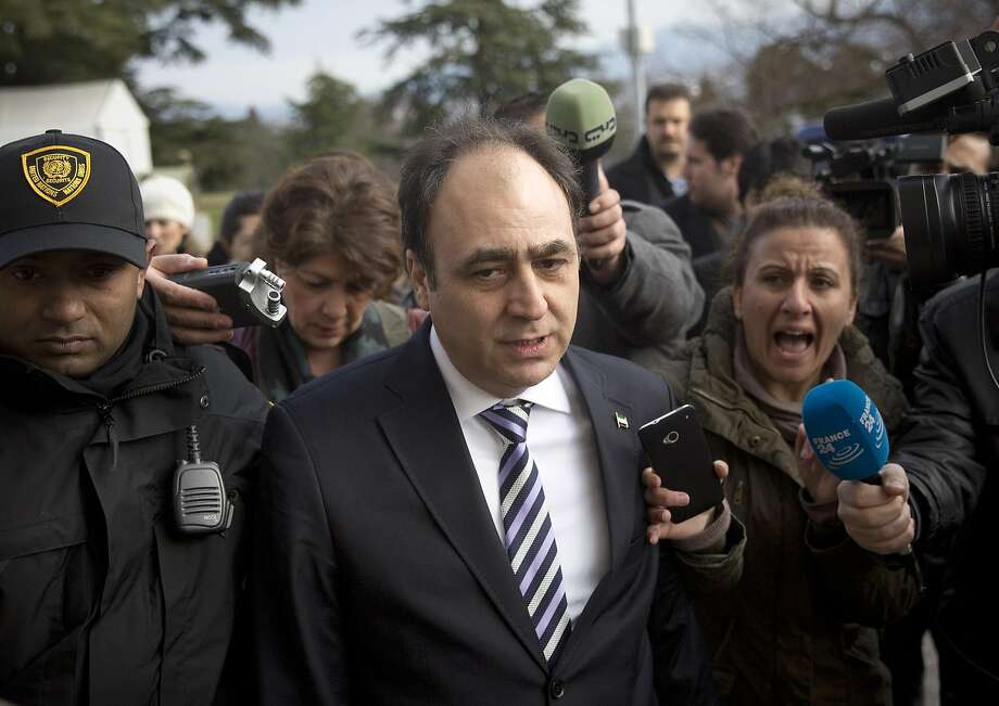 Journalists surround Monzer Akbik, a spokesman of the Syrian National Coalition opposition group, after the meeting at U.N. headquarters in Geneva. Photo: Anja Niedringhaus, Associated Press