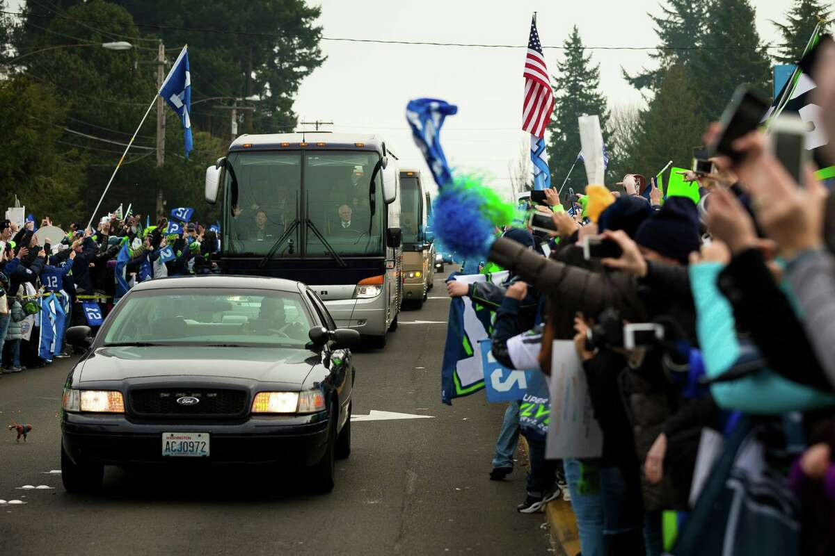 Seahawks team buses make their way to the airport en route to New York for Super Bowl XLVIII Sunday, Jan. 26, 2014, in SeaTac.