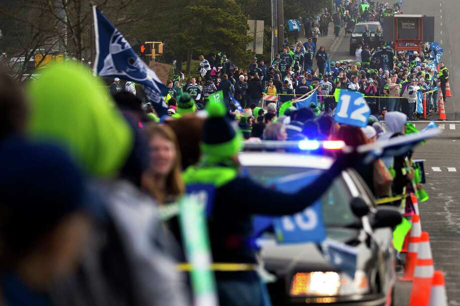 Thousands of diehard 12thMan fans lined South 188th Street to see off the Seahawks team buses on their way to the airport en route to New York for Super Bowl XLVIII Sunday, Jan. 26, 2014, in SeaTac. Photo: JORDAN STEAD, SEATTLEPI.COM / SEATTLEPI.COM