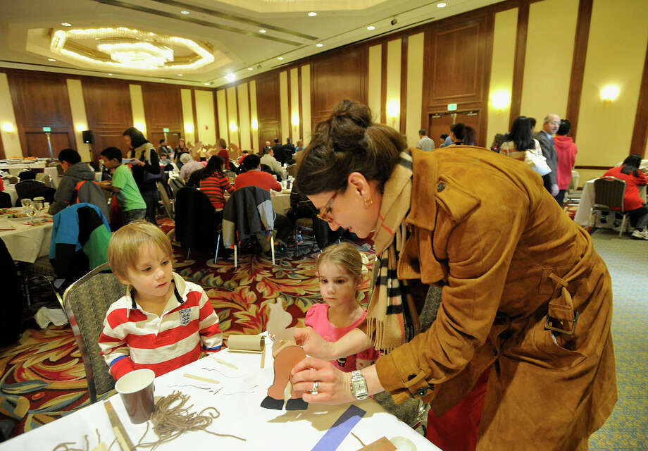 Greenwich residents Liz Magill and her children, Luke and Sophie, construct home-made horses during the Chinese Language School of Connecticut's Chinese New Year Festival heralding the year of the horse at the Hilton Stamford Hotel in Stamford, Conn., on Sunday, Jan. 26, 2014. Photo: Jason Rearick / Stamford Advocate