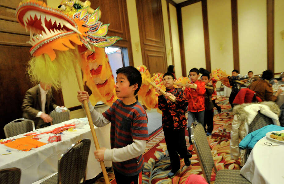 Ryan Chang leads the Dragon Dance around the auditorium during the Chinese Language School of Connecticut's Chinese New Year Festival heralding the year of the horse at the Hilton Stamford Hotel in Stamford, Conn., on Sunday, Jan. 26, 2014. Photo: Jason Rearick / Stamford Advocate