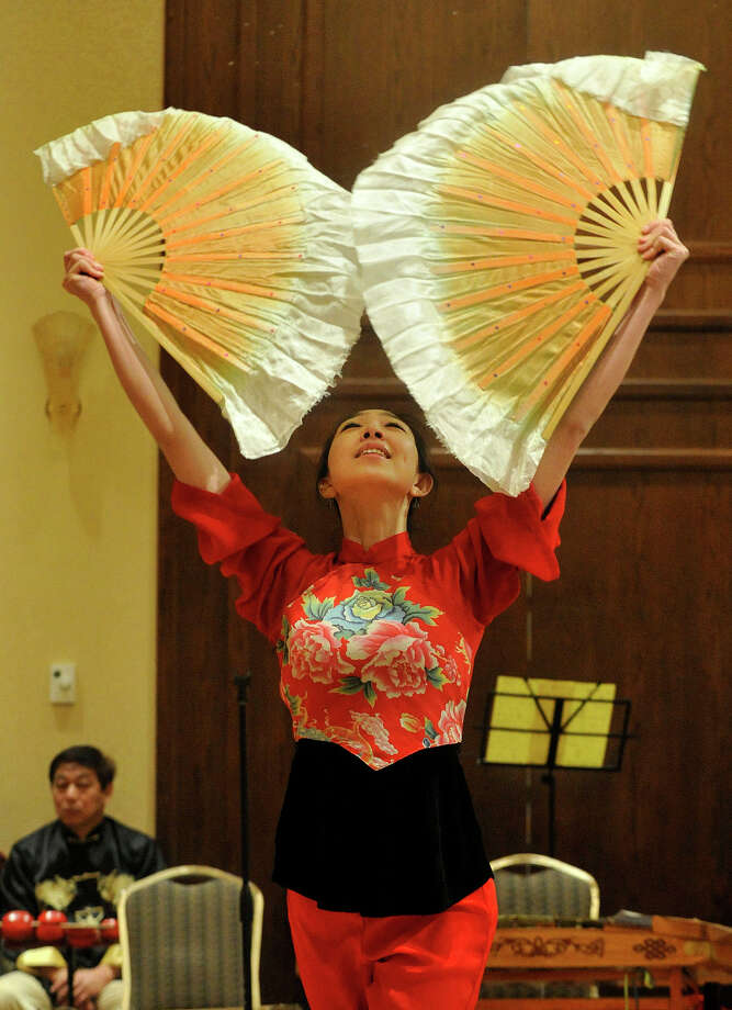 Cui Yi Xin performs the Fan Dance during the Chinese Language School of Connecticut's Chinese New Year Festival heralding the year of the horse at the Hilton Stamford Hotel in Stamford, Conn., on Sunday, Jan. 26, 2014. Photo: Jason Rearick / Stamford Advocate