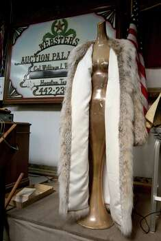 A full-size unisex fur coat went on the block at the fourth auction for the late hand doctor's estate Sunday, Jan. 26, 2014, at Webster's Auction Palace in Houston. Photo: Thomas B. Shea, The Houston Chronicle / © 2014 Thomas B. Shea