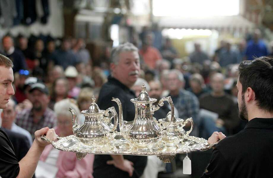 A sterling silver six-piece tea set sold for $1000. Photo: Thomas B. Shea, The Houston Chronicle / © 2014 Thomas B. Shea