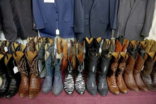 1/26/14: Dozens of cowboy boots, shirts, ties and suits were for auction at the fourth Dr. Michael Brown auction at Webster's Auction Palace in Houston, Texas,  On March 16, 2014 Dr. Brown's gun safes and and over $300,000 Montblanc pens will be for auction. The Bentwater and Memorial house items still need to be auctioned off sometime in April 2014. Photo: Thomas B. Shea, The Houston Chronicle / © 2014 Thomas B. Shea