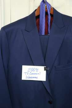 Bidders also flocked to one of the suits that Michael Brown wore for his TV commercials. Photo: Thomas B. Shea, The Houston Chronicle / © 2014 Thomas B. Shea