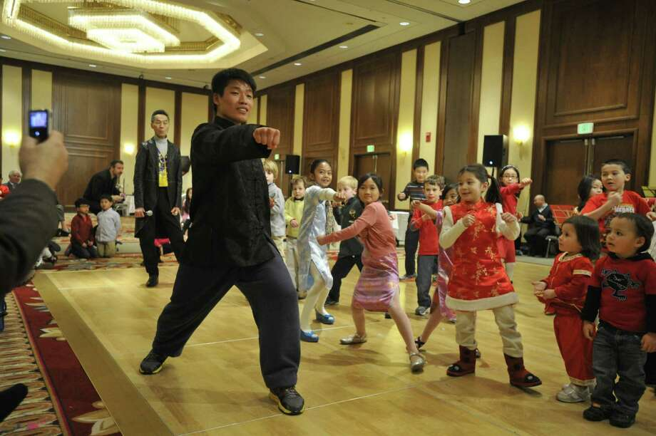 Xiaodeng Chen demonstrates his kung fu techniques during the Chinese Language School of Connecticut's Chinese New Year Festival heralding the year of the horse at the Hilton Stamford Hotel in Stamford, Conn., on Sunday, Jan. 26, 2014. Photo: Jason Rearick / Stamford Advocate