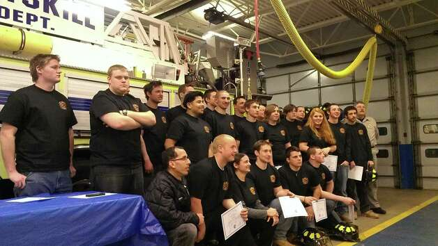 A group of volunteer firefighters from Rensselaer County departments and one from Albany County received NYS Firefighter 1 certifications after a training program. The graduates, most of them ages 17 to 19, gathered Wednesday, Jan. 22, at the Wynantskill Fire Hall.  (Courtney Rubin, East Greenbush)