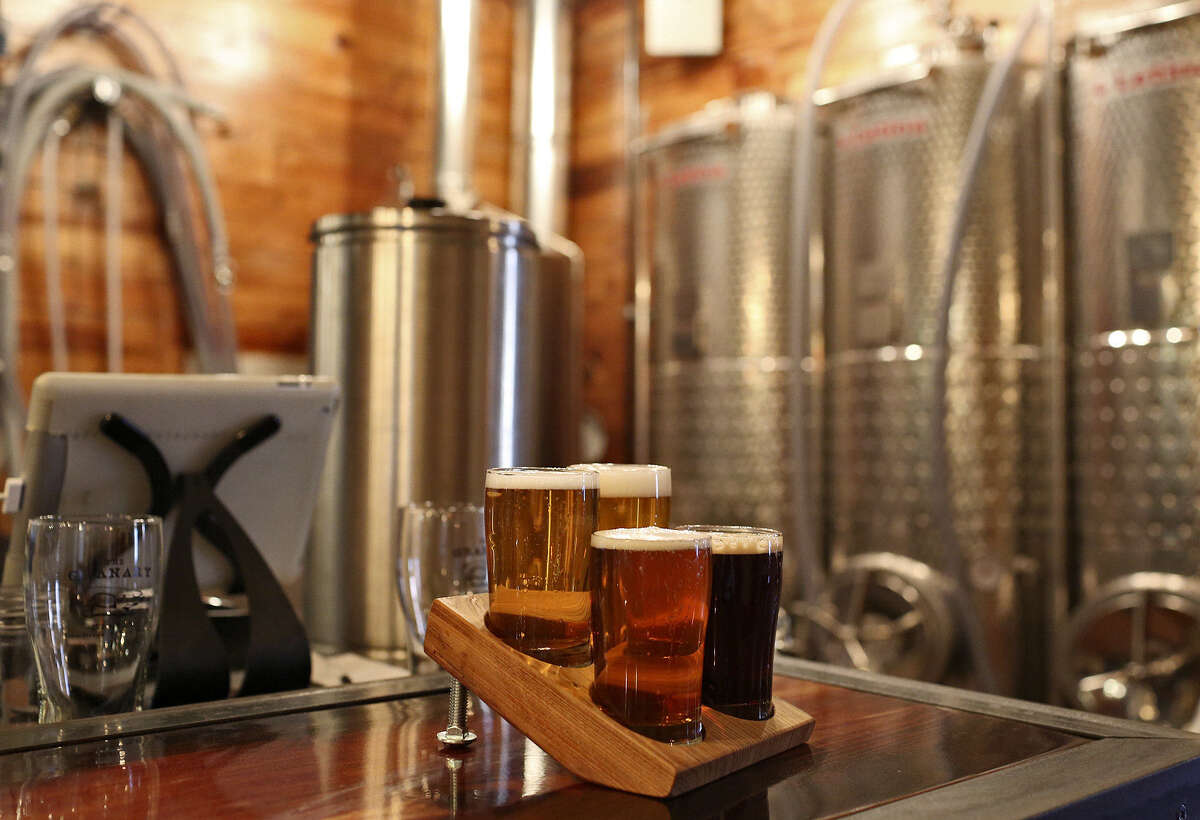 More craft breweries encourage more craft beer, say craft brewers in the San Antonio area. Here, a flight of brews awaits a customer at The Granary at the Pearl.