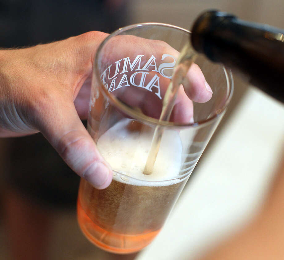 A taste of a Busted Sandal Brewing Co. test brew fills a glass. Busted Sandal is one of four area breweries that have opened in the past year. / © Jennifer Whitney