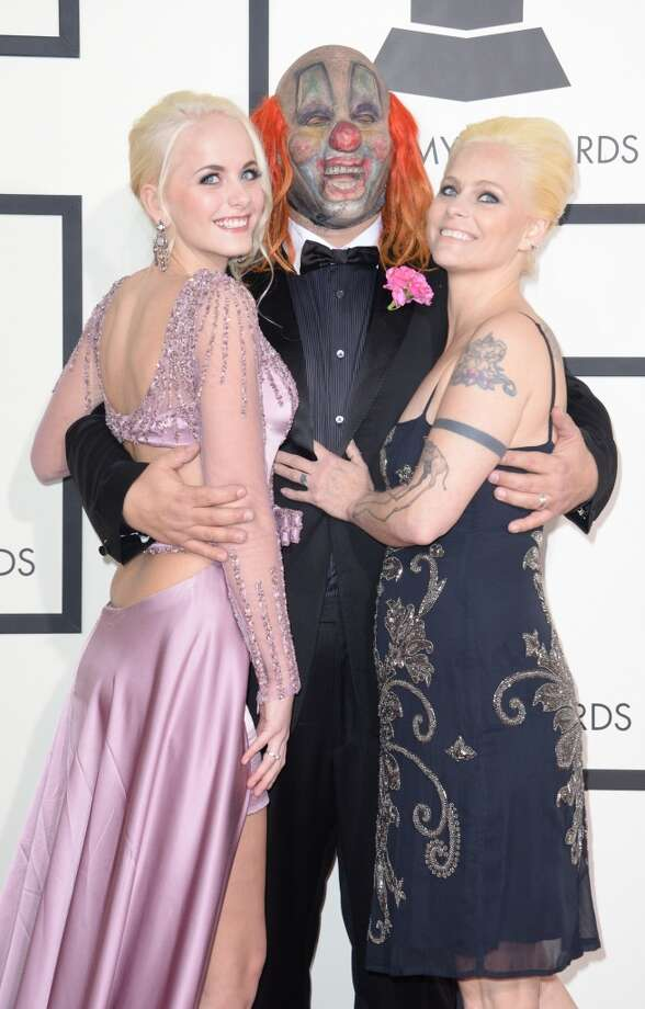Slipknot Clown and his wife and daughter arrive on the red carpet for the 56th Grammy Awards at the Staples Center in Los Angeles, California, January 26, 2014. Photo: ROBYN BECK, AFP/Getty Images