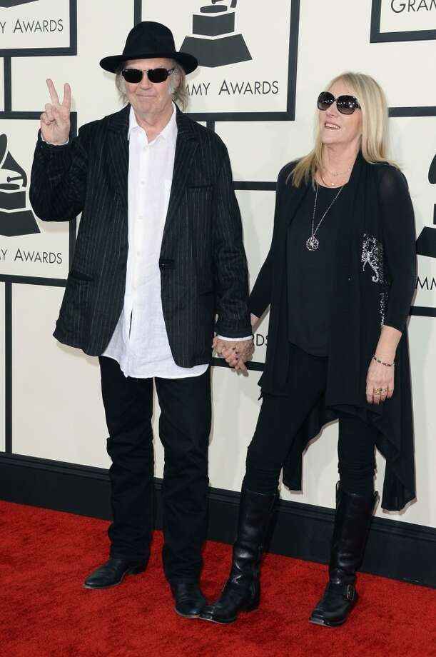 Singer-songwriters Neil Young (L) and Pegi Young attend the 56th GRAMMY Awards at Staples Center on January 26, 2014 in Los Angeles, California. Photo: Jason Merritt, Getty Images