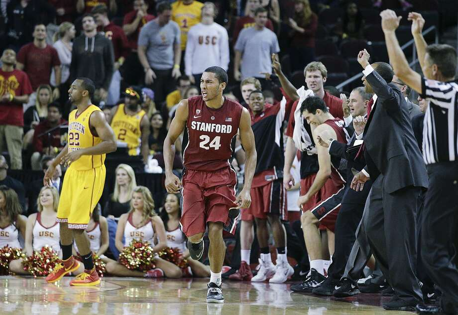Stanford 's Josh Huestis reacts after making a three-point-basket against Southern California in the second half of an NCAA college basketball on Sunday, Jan. 26, 2014, in Los Angeles. Stanford won 79-71 in overtime. (AP Photo/Jae C. Hong) Photo: Jae C. Hong, Associated Press