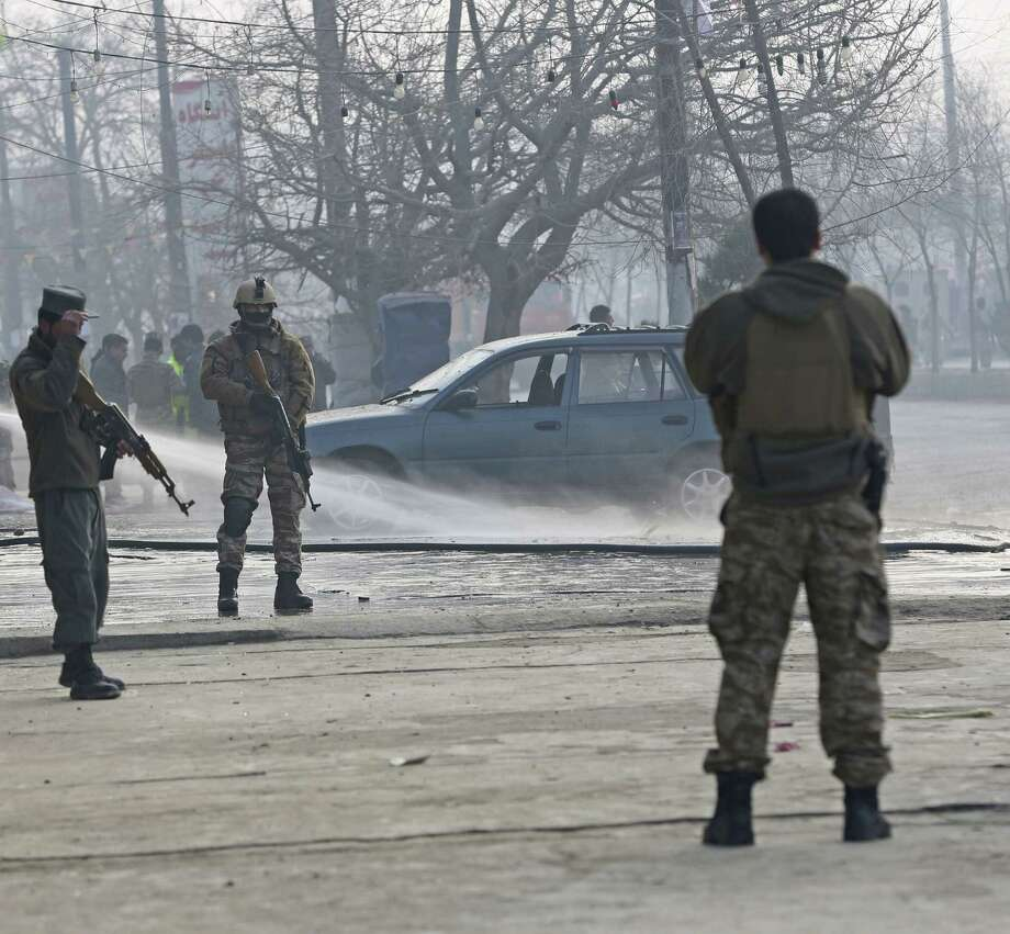 Security personnel stand guard at the site of a suicide attack in Kabul, Afghanistan. Photo: Associated Press / AP