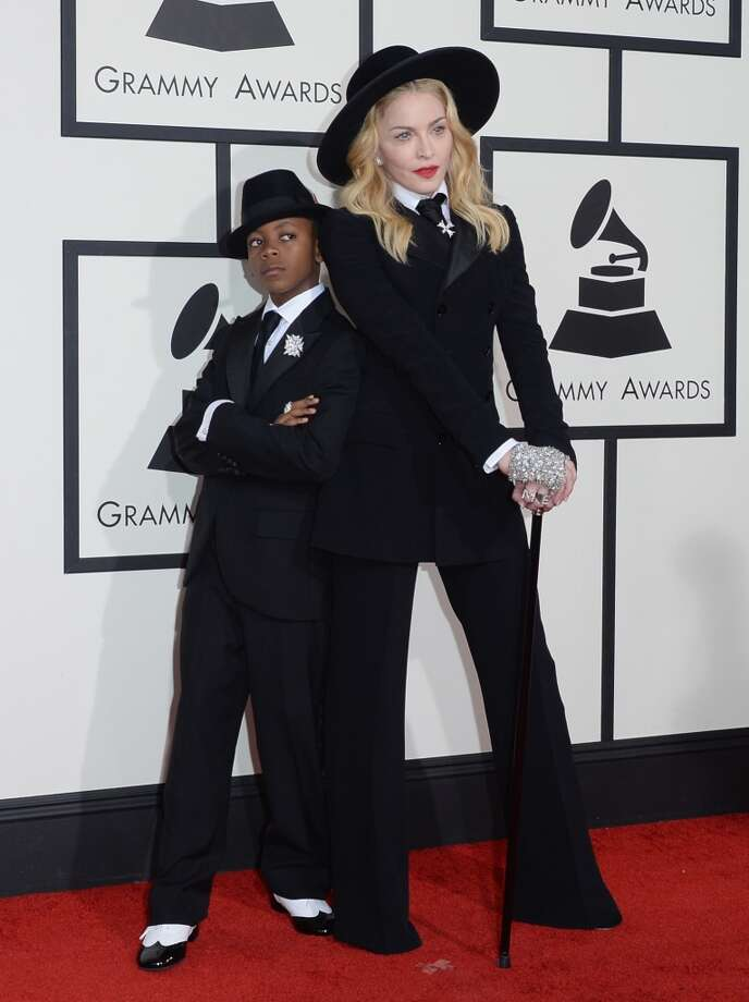 Singer Madonna (R) and son David Banda Mwale Ciccone Ritchie attend the 56th GRAMMY Awards at Staples Center on January 26, 2014 in Los Angeles, California. Photo: Jason Merritt, Getty Images
