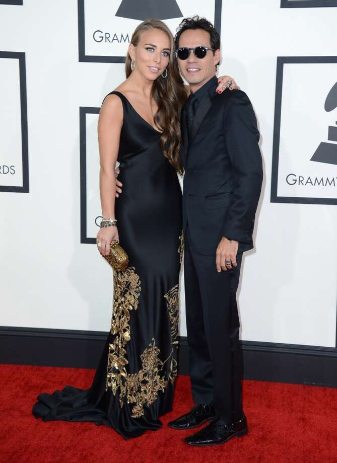 Chloe Green, left, and Marc Anthony arrive at the 56th annual Grammy Awards at Staples Center on Sunday, Jan. 26, 2014, in Los Angeles. Photo: Jordan Strauss, Associated Press
