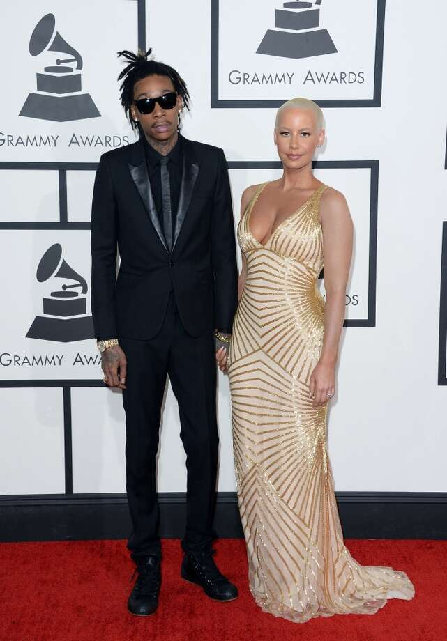 Rapper Wiz Khalifa (L) and model Amber Rose attend the 56th GRAMMY Awards at Staples Center on January 26, 2014 in Los Angeles, California. Photo: Jason Merritt, Getty Images