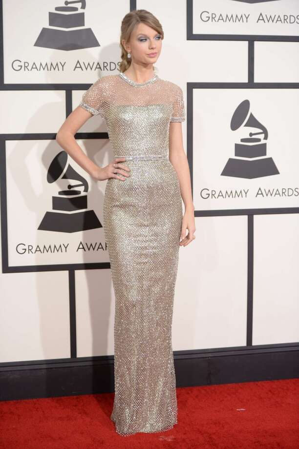 Taylor Swift arrives on the red carpet for the 56th Grammy Awards at the Staples Center in Los Angeles, California, January 26, 2014. Photo: ROBYN BECK, AFP/Getty Images
