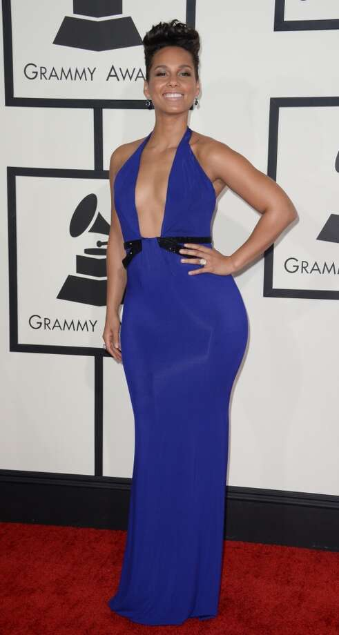 Alicia Keys arrives on the red carpet for the 56th Grammy Awards at the Staples Center in Los Angeles, California, January 26, 2014. Photo: ROBYN BECK, AFP/Getty Images