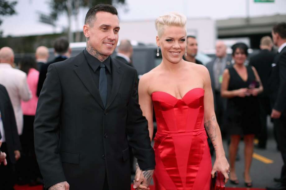 Off-road truck racer Carey Hart and singer Pink attend the 56th GRAMMY Awards at Staples Center on January 26, 2014 in Los Angeles, California. Photo: Christopher Polk, Getty Images For NARAS