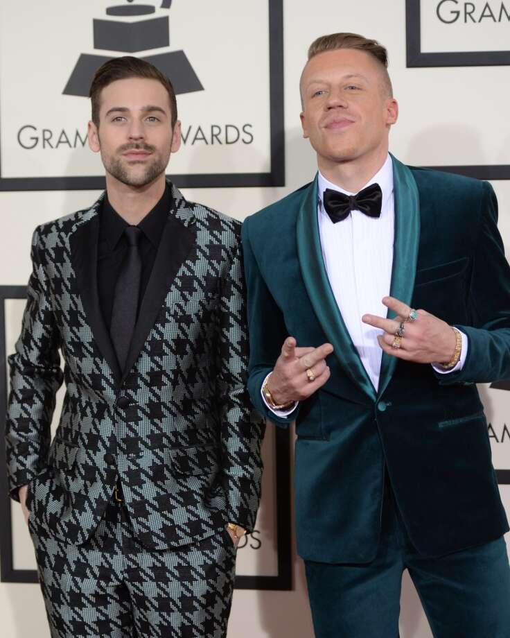 "Nominees For Best Rap Album ""The Heist"" Macklemore and Ryan Lewis arrive on the red carpet  during the 56th Grammy Awards at the Staples Center in Los Angeles, California, January 26, 2014. Photo: ROBYN BECK, AFP/Getty Images"