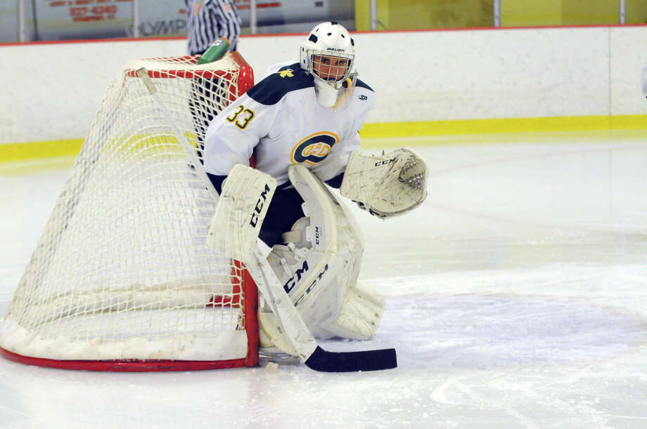 Trinity goalie Kyle Odierno in action as Darien and Trinity Catholic High Schools face off in a boys hockey game at Terry Conners Rink in Stamford, Conn., Jan. 25, 2014. Photo: Keelin Daly / Stamford Advocate Freelance