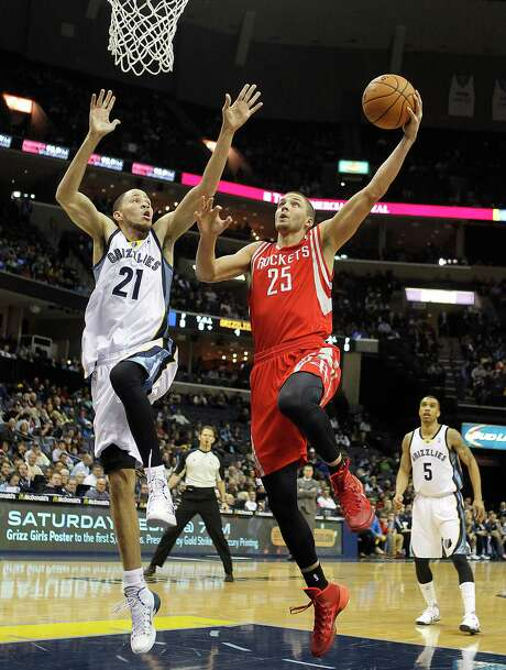 The latest example of the Rockets' inconsistency was the shooting of Chandler Parsons, who goes to the basket against the Grizzlies' Tayshaun Prince on Saturday night. Parsons was 1-for-6 on 3-pointers a night after going 10-for-14 against the same team. Photo: Lance Murphey, FRE / FR78211 AP