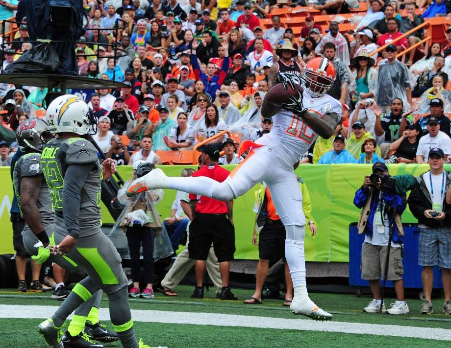 Josh Gordon #12 of the Browns and Team Rice makes a catch for a touchdown. Photo: Scott Cunningham, Getty Images