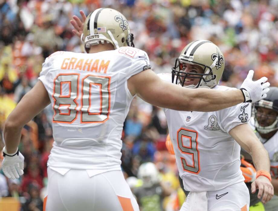 Saints tight end Jimmy Graham (80) is congratulated by Saints quarterback Drew Brees (9) of Team Rice after catching a pass for a touchdown. Photo: Eugene Tanner, Associated Press