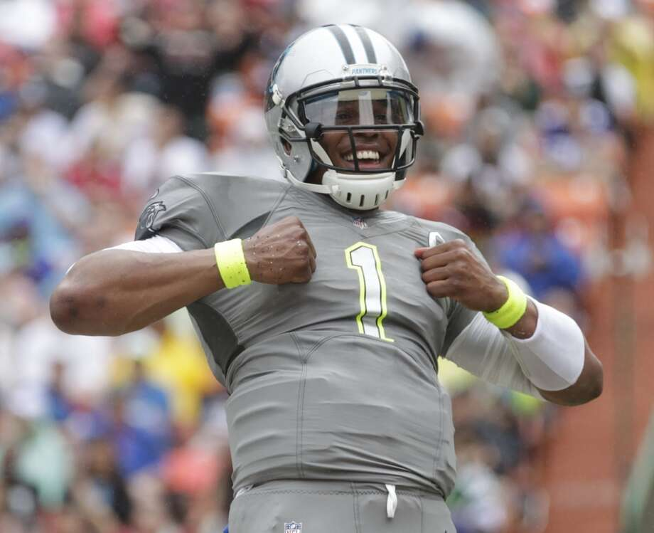 Panthers quarterback Cam Newton (1) of Team Sanders celebrates his touchdown. Photo: Eugene Tanner, Associated Press