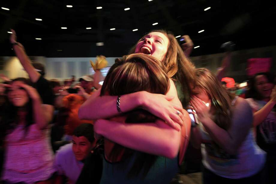 (center) Monica Bradbery, 22, is embraced by Brooke Stanfield as Danielle Bradbery is announced the winner of THE VOICE as a crowd cheers during a finale watch party at Community of Faith on Tuesday, June 18, 2013, in Hockley. Photo: Mayra Beltran / © 2013 Houston Chronicle