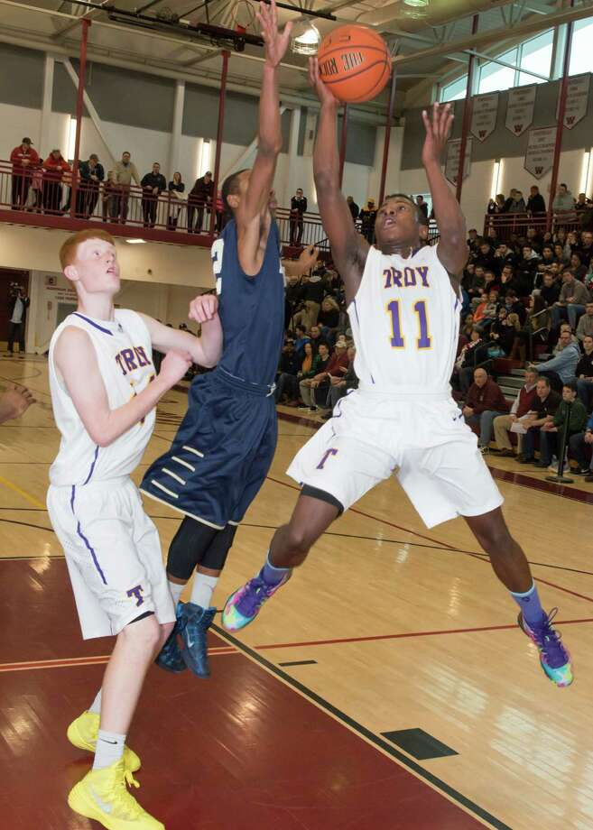 Troy's Dyaire Holt, right, and Jack McLaren, left, battle for the ball with Newburgh Free Academy's Dante Davis in their game Sunday at Watervliet High School. (Shawn Morgan Photography/ Special to the Times Union)